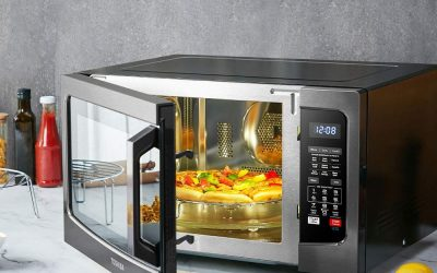 What happens when you stand in front of a microwave oven?
